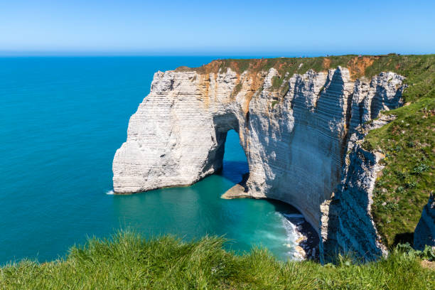 Aiguille Etretat cliff on the sea side and its beautiful limestone cliffs Aiguille Etretat cliff on the sea side and its beautiful limestone cliffs manche stock pictures, royalty-free photos & images