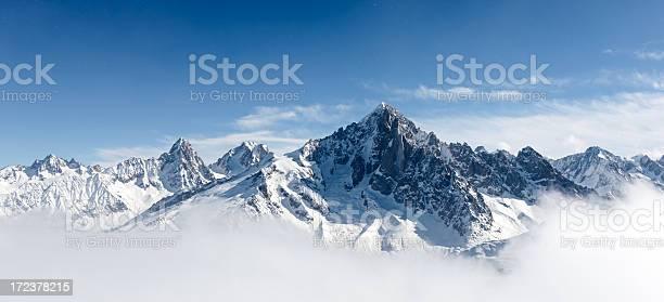Photo of Aiguille Verte between clouds
