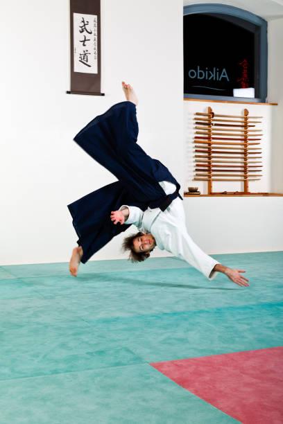 Aikido falling technique stock photo