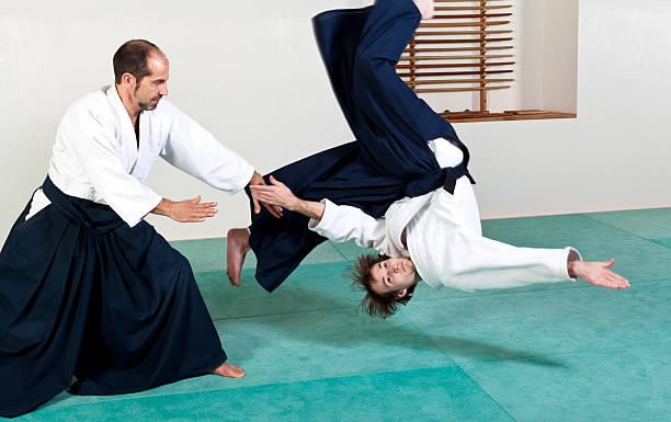 Aikido throw technique stock photo