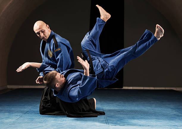 Aikido throwing technique. stock photo
