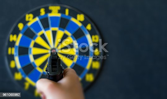 istock aim at the target with the pistol 961065982