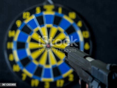 istock aim at the target with the pistol 961065988