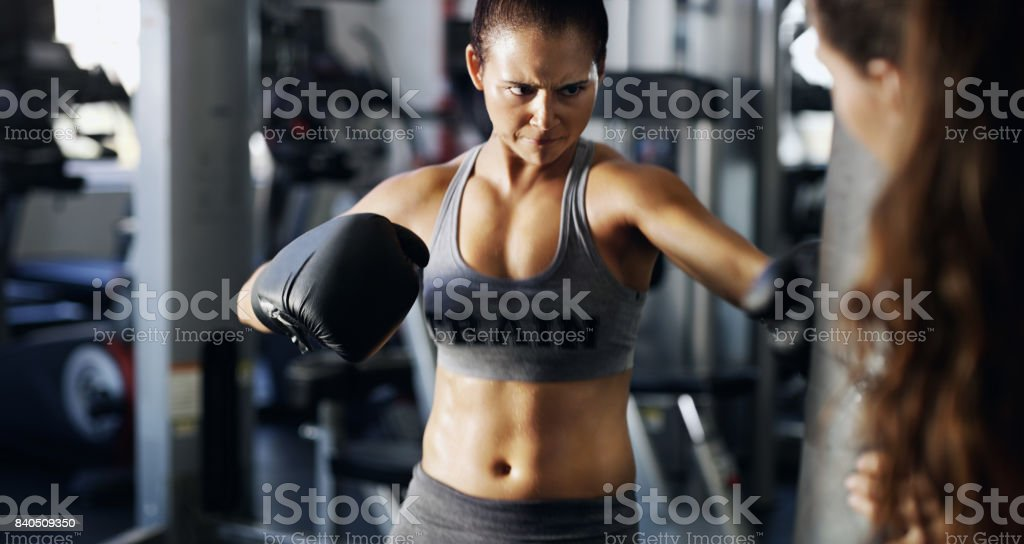 Aim your punches THROUGH the bag stock photo