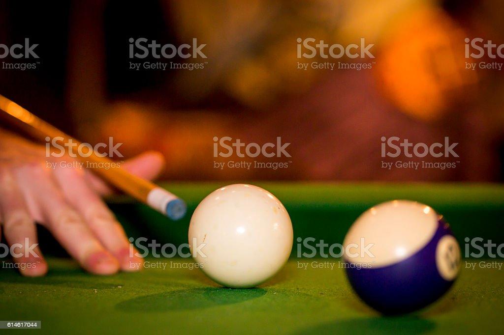 Playing billiard in club. Close up.