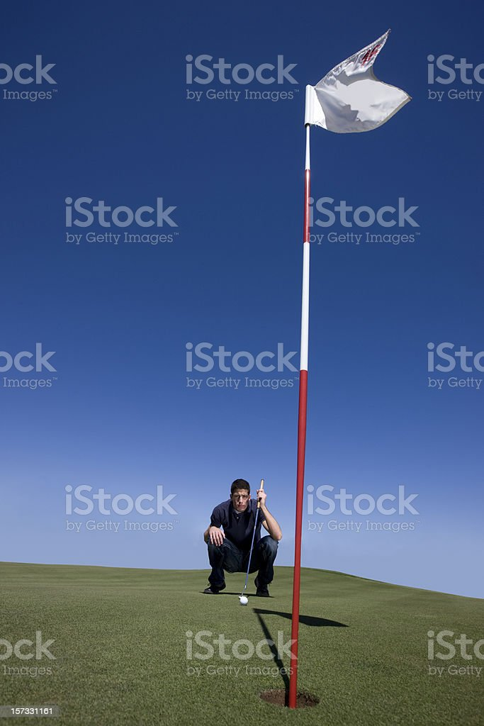 Aiming for Putting Golf Ball royalty-free stock photo