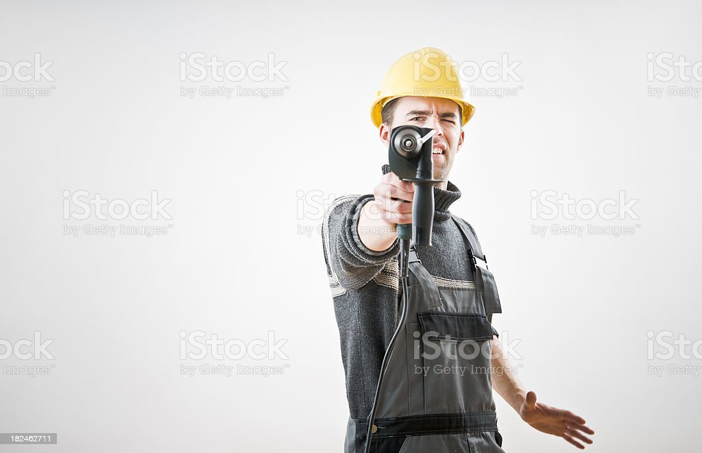 Aiming with a Drill royalty-free stock photo