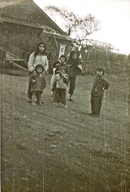 Ainu Children The Ainu (Japanese: アイヌ?), also called Aynu, Aino (アイノ?), and in historical texts Ezo (蝦夷?), are an indigenous people in Japan (Hokkaido)  war effort stock pictures, royalty-free photos & images