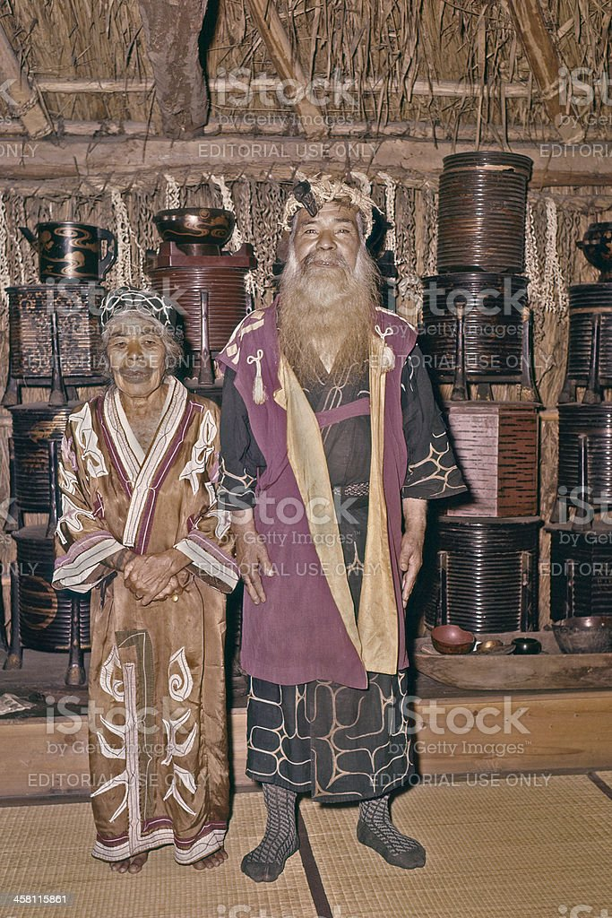 Ainu couple inside. stock photo