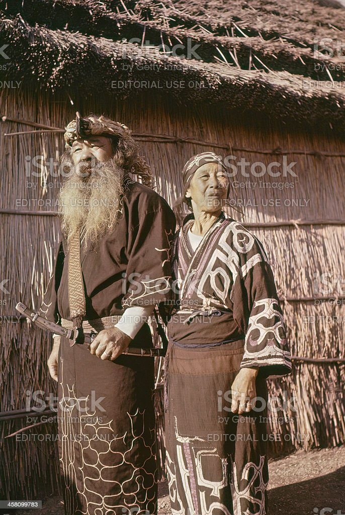 Ainu couple outside. stock photo