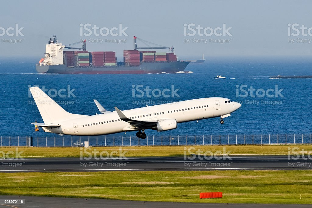 Aiplane and Cargoship stock photo