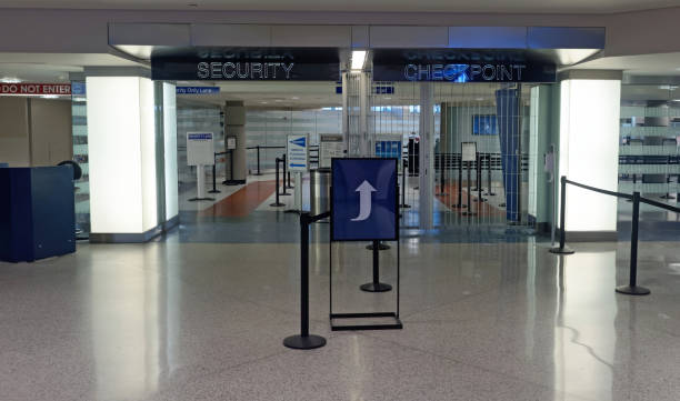 Aiport Checkpoint Empty airport terminal security checkpoint. security barrier stock pictures, royalty-free photos & images