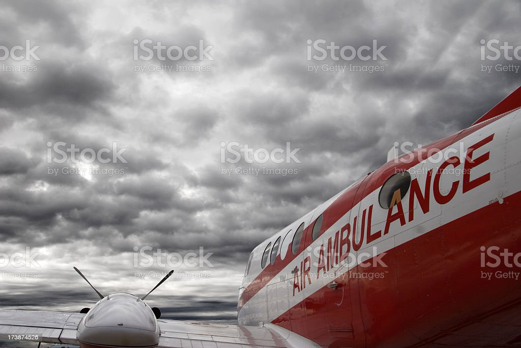 Air ambulance airplane on overcast cloudy day stock photo