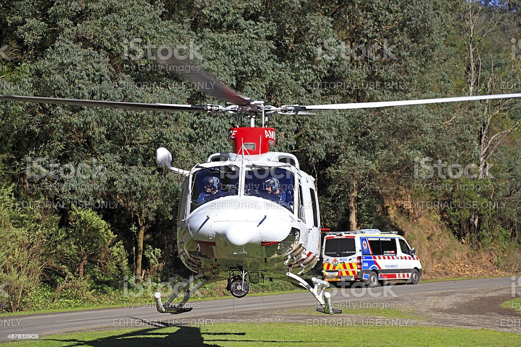 Air ambulance helicopter evacuates rural accident victim to hospital stock photo