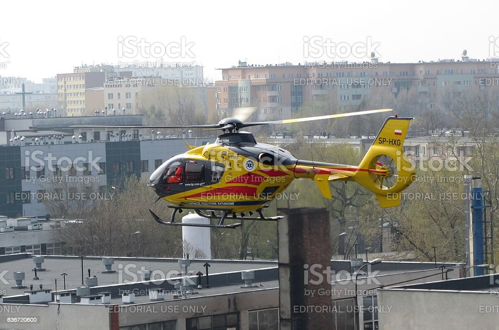 Air ambulance helicopter flying above the city stock photo