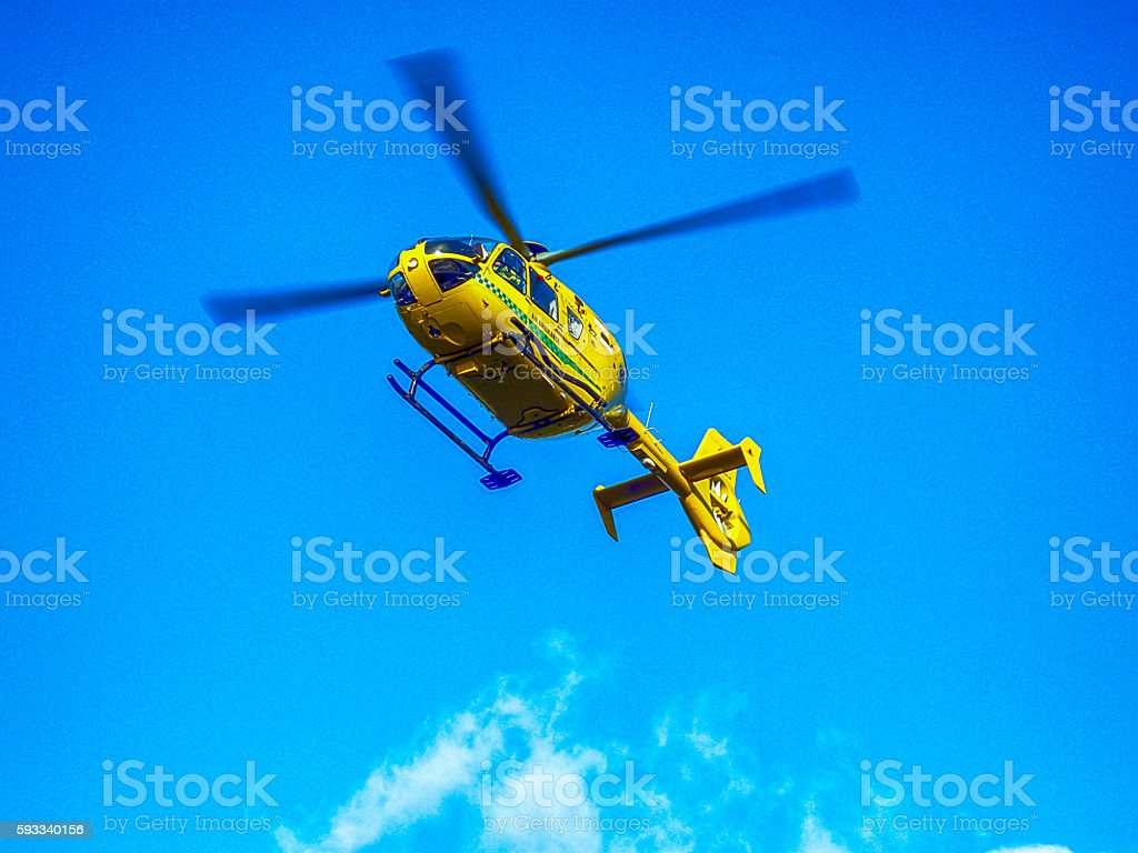 Air Ambulance helicopter in the sky above Sherborne, UK stock photo