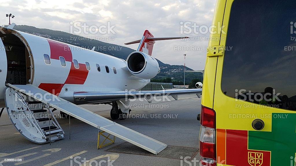 Air ambulance meets road ambulance stock photo