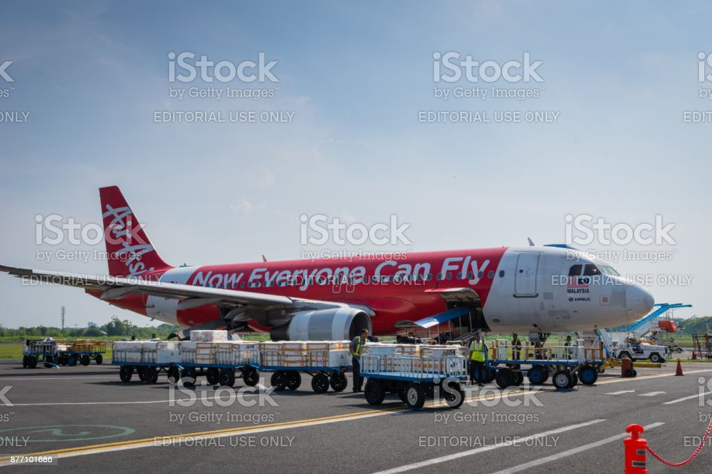 Air Asia Airbus landed at sunrise in Indonesia stock photo