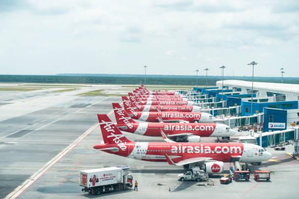 Air Asia aircrafts docking at KLIA2, Kuala Lumpur International Airport 2 Jan 2020 - Kuala Lumpur, Malaysia - Air Asia aircrafts docking at KLIA2, Kuala Lumpur International Airport 2 kuala lumpur airport stock pictures, royalty-free photos & images