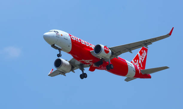 Air Asia Flight Sepang, Malaysia - February 08, 2019 : Air Asia Low Cost Airlines aircraft. AirAsia Group operates scheduled domestic and international flights to more than 165 destinations spanning 25 countries. kuala lumpur airport stock pictures, royalty-free photos & images