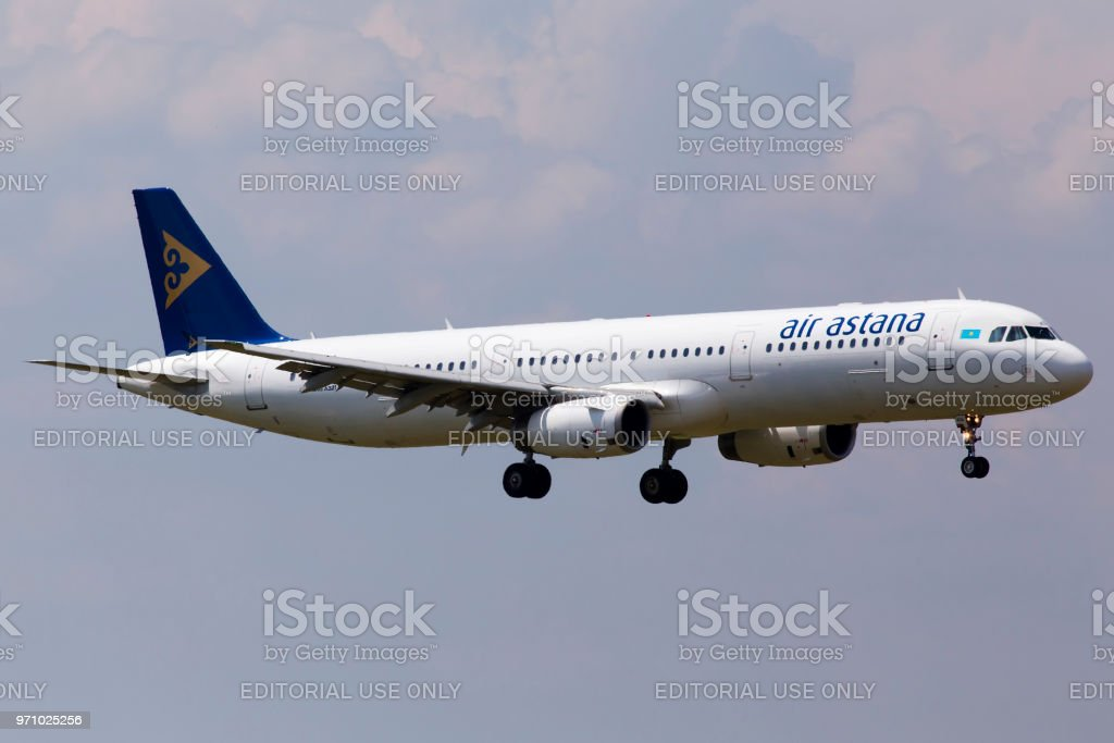 P4-KDA Air Astana Airbus A321-200 aircraft on the blue sky background stock photo