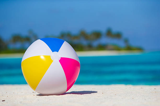 air ball at beach with turquoise sea and blue sky - beach ball stock photos and pictures