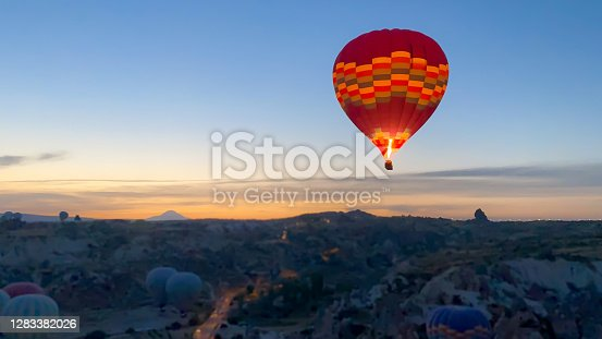 Air balloon at sunrise over the beautiful landscape in Kapadokya, Turkey