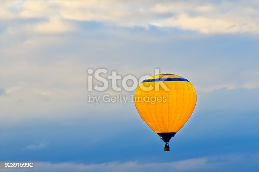 Air balloon on a blue sky background