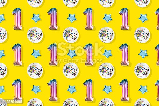 1093222958istockphoto Air Balloons of number one and ball shaped  foil on pastel pink background.  Minimalistic composition of metallic balloon. Holiday celebration.Metallic balloon. 1155854096