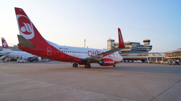 Air Berlin Boeing 737 parking at the apron of Tegel Airport. Homebase of Air Berlin is Tegel airport. stock photo