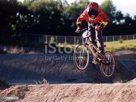 BMX biker during a practice session at a local park. Plenty of room for copy on the left. Would enjoy knowing how you used this photo.