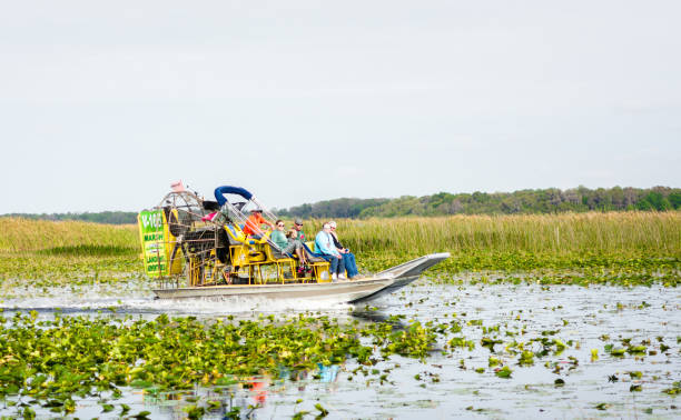 air boat on florida lake - kissimmee stock photos and pictures