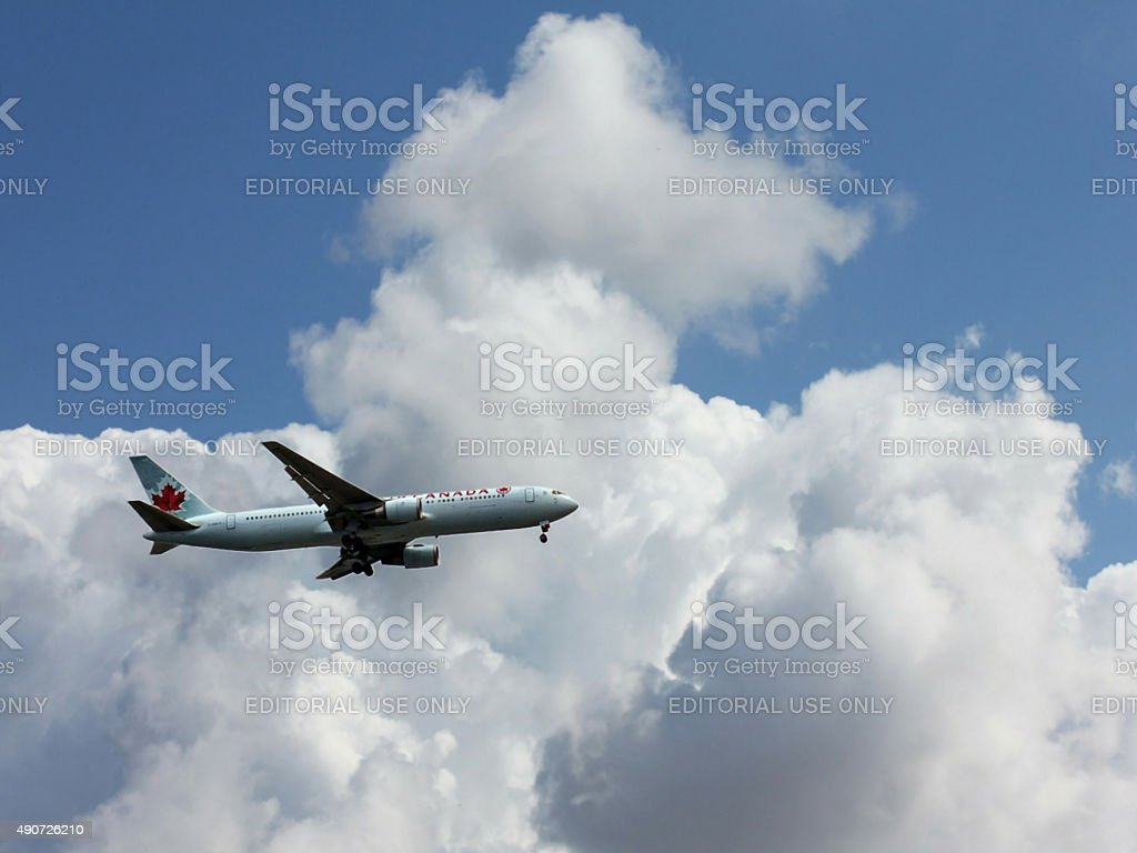 Air Canada plane is preparing to land in Airport stock photo