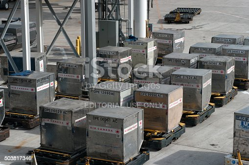 Toronto, Canada - August 27, 2009: Air Canada shipping containers on the tarmack at Pearson International Airport in Toronto. Air Canada is the flag carrier and largest airline of Canada. The airline, founded in 1937, provides scheduled and charter air transport for passengers and cargo to 178 destinations worldwide.