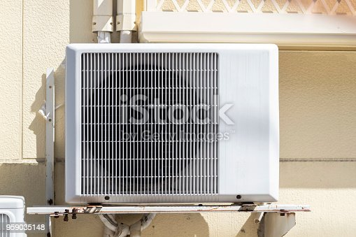 947099530 istock photo Air compressor installation on building wall 959035148