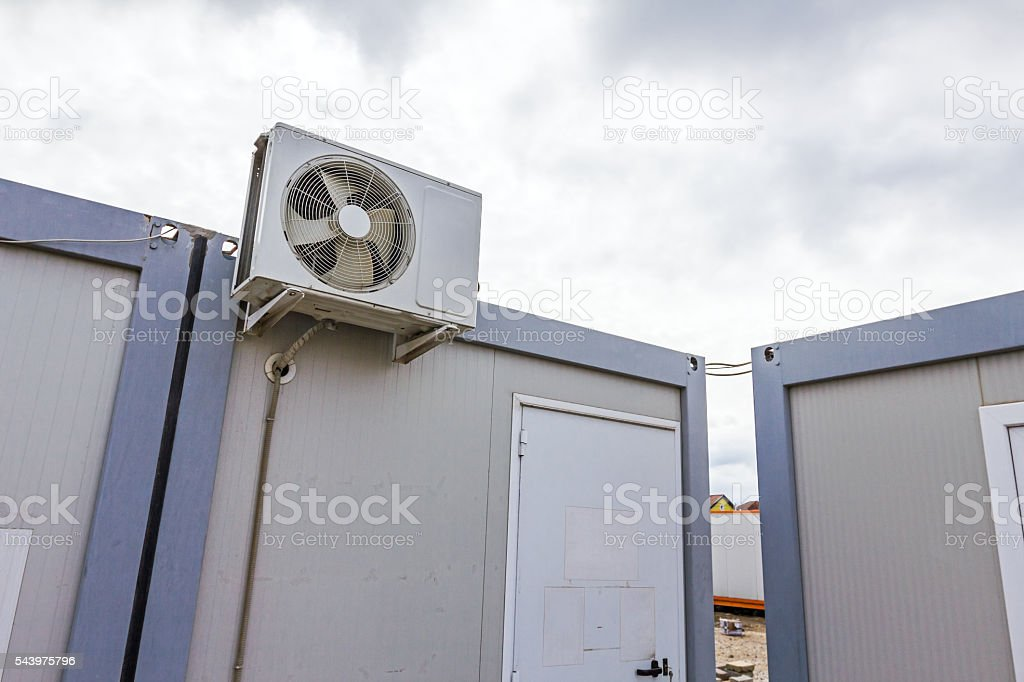 Outdoor unit, compressor, of air conditioner is placed on white...