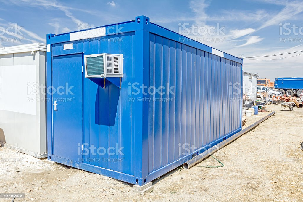 Air compressor is set on the wall of container office stock photo