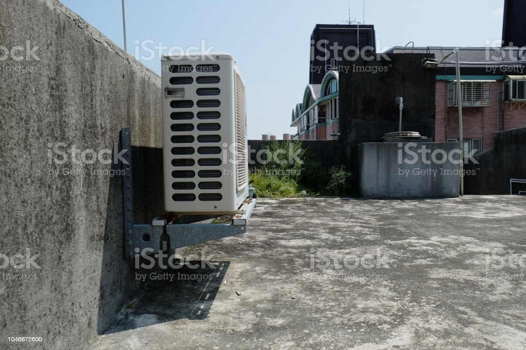 Air compressor machine part of air conditioner system on roof deck. stock photo