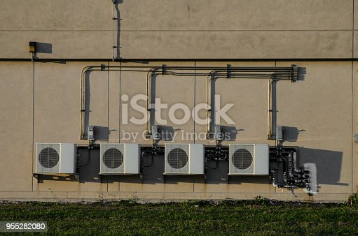 istock Air compressor on concrete wall 955282080