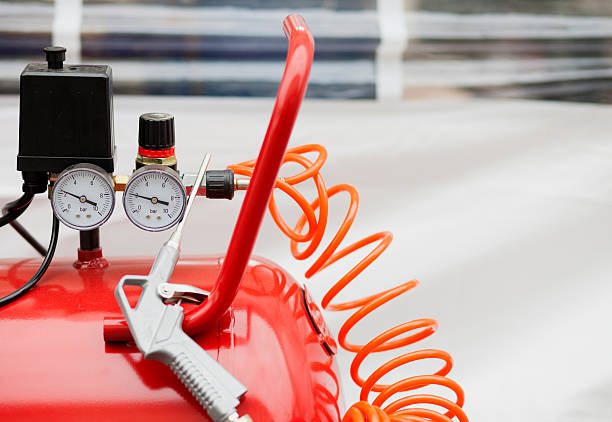 Air compressor system Air compressor system: manometer, cable, gun and accessories, closeup. compressor stock pictures, royalty-free photos & images