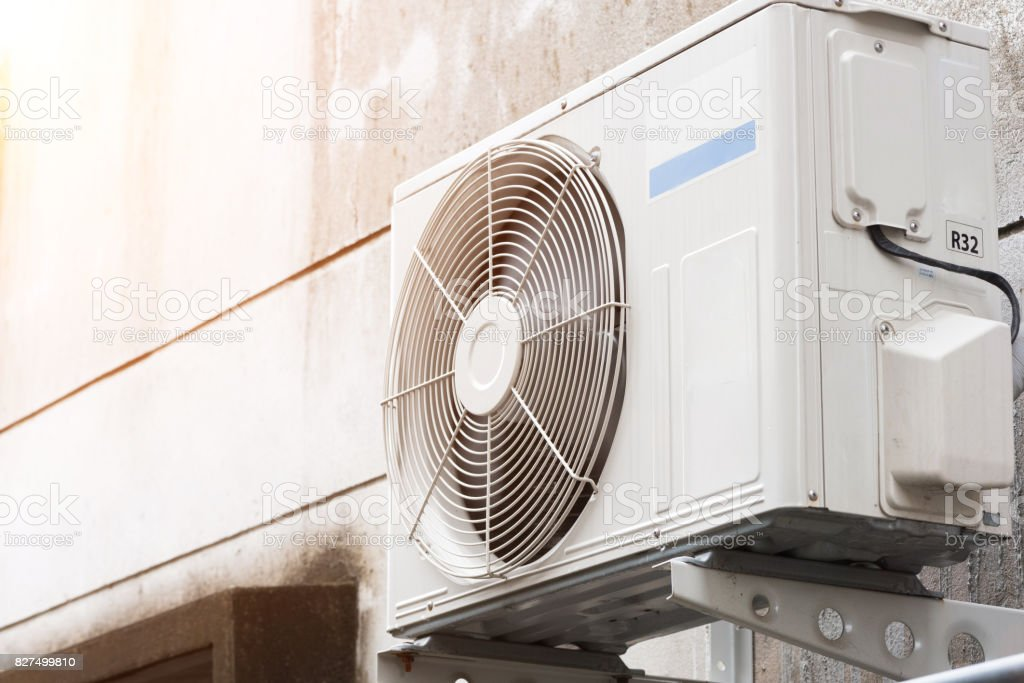 Air compressors are installed at the wall outside the room. stock photo