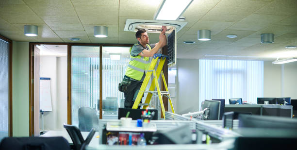 air con maintenance engineer air con maintenance engineer in empty office floor repairing stock pictures, royalty-free photos & images