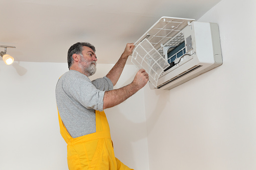 Air Condition Examine Or Install Stock Photo - Download Image Now