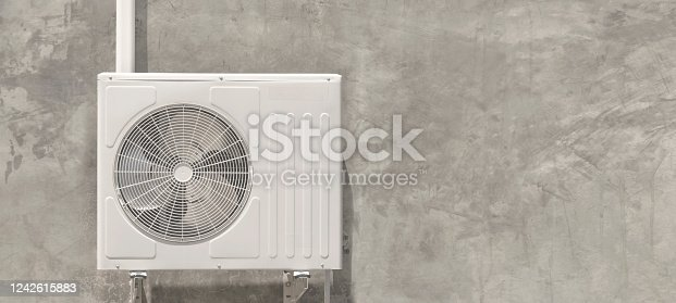 939450782 istock photo Air condition outdoor unit compressor install outside the house 1242615883