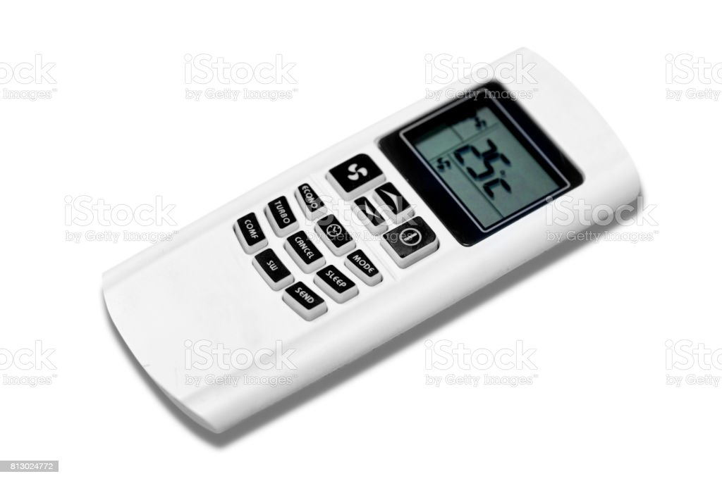 Air condition remote on the wooden table in the meeting room and setting temperature at 25 degree celcius. stock photo