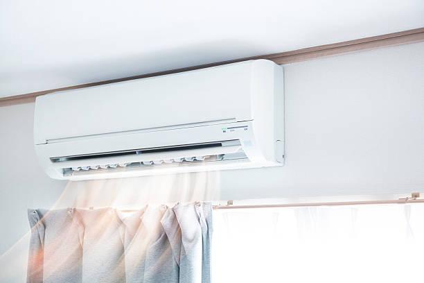 Air conditioner blowing warm air Air conditioner blowing warm air small stock pictures, royalty-free photos & images