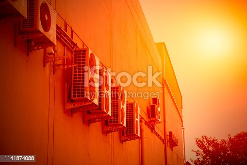 939450782 istock photo air conditioner compressor generate heat in hot summer season global warming concept 1141874088