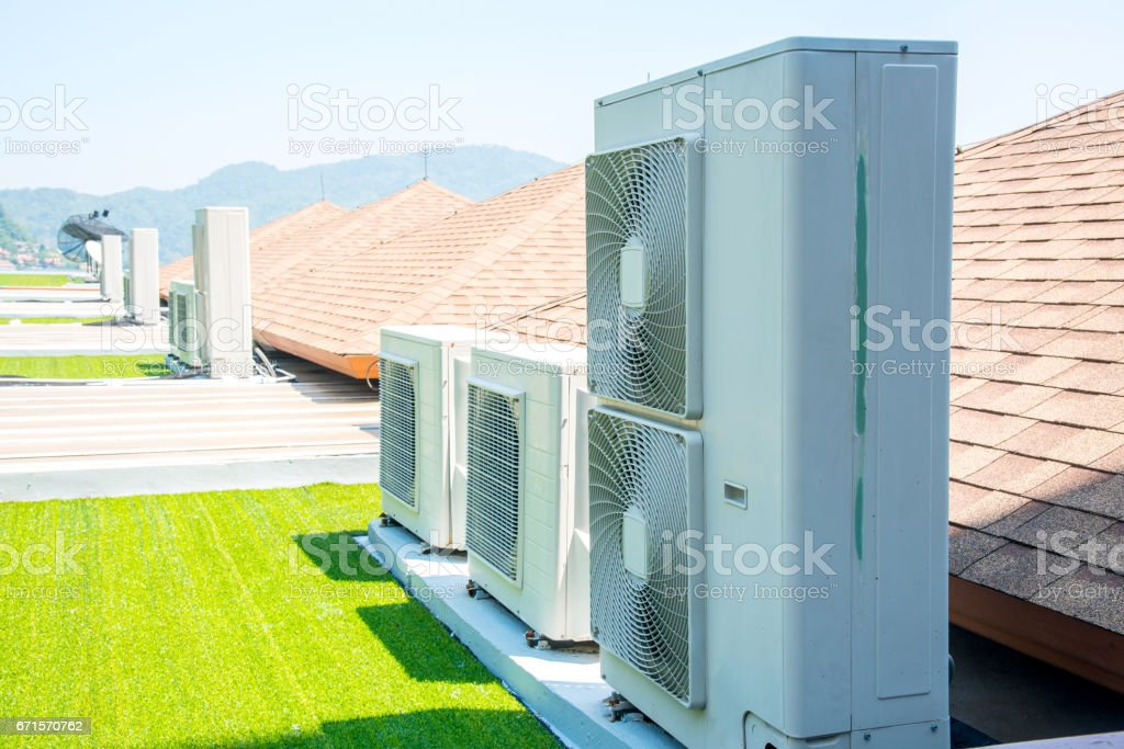 Air conditioner compressor installed on the roof of the building. stock photo