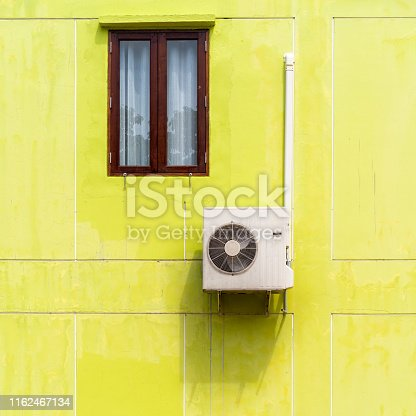 871063730istockphoto Air conditioner compressor mounted on a wall 1162467134