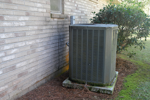 istock Air Conditioner Compressor near gray brick house 1072750570